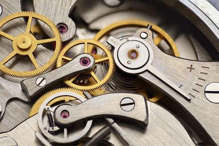 Analog mechanical stopwatch mechanism gears inside. Macro shot. Stock Photo
