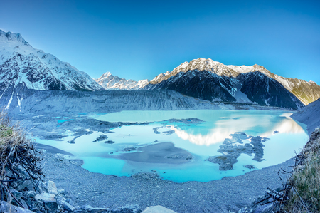 View of Mount Cook (Aoraki), Mount Wakefield, Mueller Glacial Lake and Mueller Lateral Moraine from Kea Point, New Zealand during early Spring Stock Photo