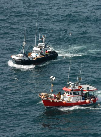 Two fishing boats on the sea photo