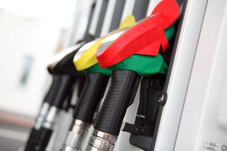 Several gasoline pump nozzles at petrol station    Stock Photo