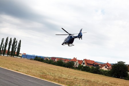 Blue and silver police helicopter flying above Stock Photo - 7576941