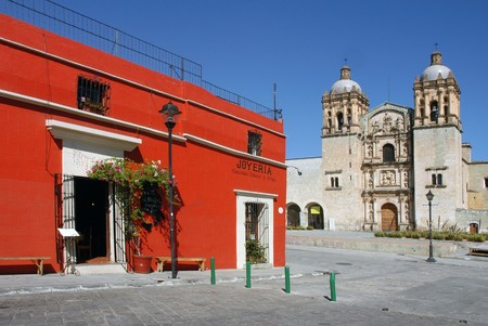 View of cathedral and red house in Oaxaca city in Mexico Stock Photo
