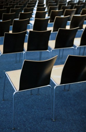 Empty room with many chairs on blue carpet Stock Photo - 7750112
