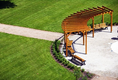 Garden with wooden construction and benches Stock Photo