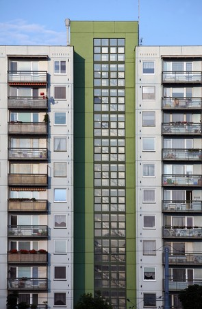 Green and grey prefab house with many balcons and windows Stock Photo - 7750268