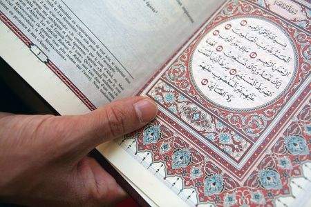 Pages of Koran translated to French language