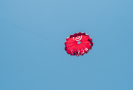 parachutists: ALGARVE COAST, PORTUGAL - MAY 19: Flying parachutists in the sky near the Algarve coast in Portugal, 2016 Editorial