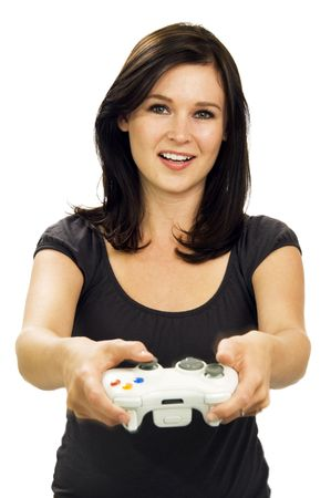 actively: Casual dressed, smiling girl actively works a video game controller.
