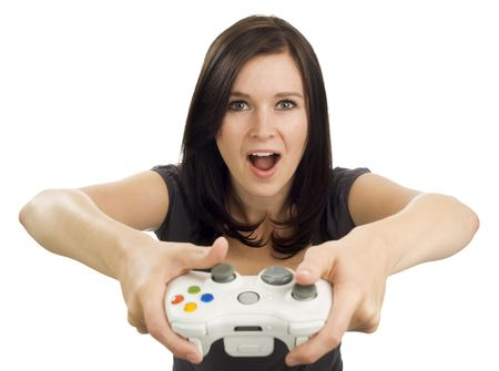 controller: Girl holds a video game controller with her mouth open, exclaiming. Stock Photo