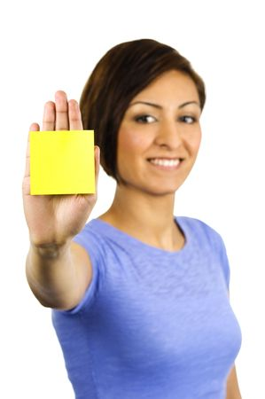 Young ethnic woman has a sticky note stuck on the palm of her hand. Photographed on a white background of +2 EV. photo