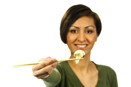 Smiling lady holds a piece of cooked cauliflower with chopsticks. Photographed against a white background at +2 EV. Stock Photo - 6786375
