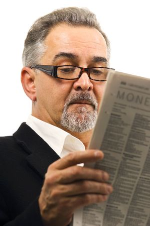 A mature man calmly and casually reading his newspaper.