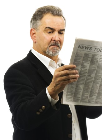 Business man reads and studies todays news with a serious look. photo