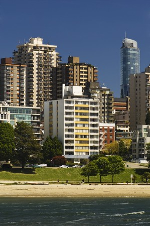 Apartments face the water and beach in the city. photo
