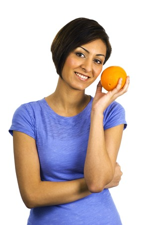 indian blue: A young, pretty ethnic woman holds an orange. Stock Photo