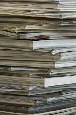 Vertical image of the edges of a stacked pile of magazines. Stock Photo