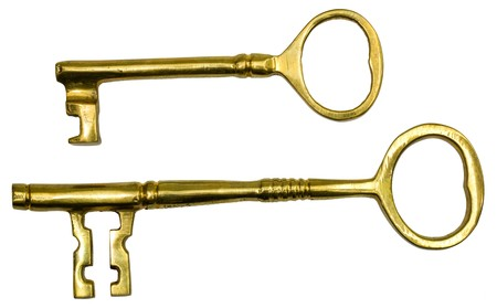 Two different-sized, gold, skeleton keys on a white background.