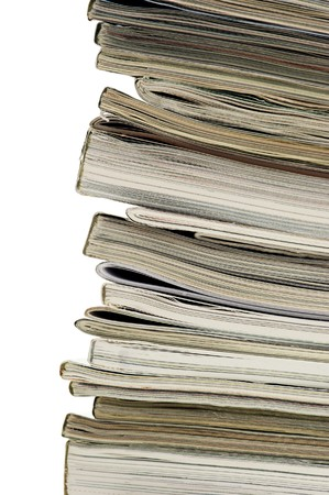 Vertical image of the spine and ends of a stacked pile of magazines. Stock Photo