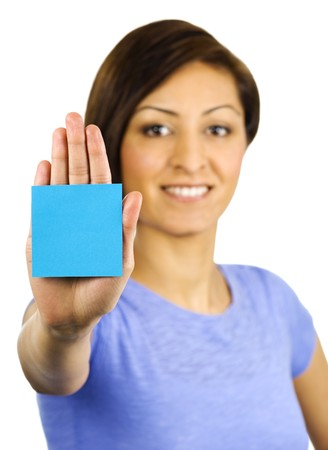 A pretty, young ethnic woman has a sticky note stuck on the palm of her hand. Photographed with a white background