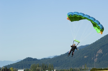 Abbotsford, British Columbia, Canada - July 24, 2010: Mature woman comes in for a landing with her parachute. The sport is not just for the young, as this mature woman comes in for a landing.