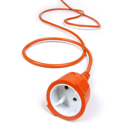 coiled: orange extension cord on white background