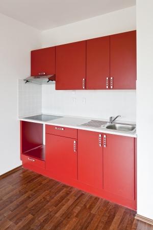 kitchenette: new red kitchen Stock Photo