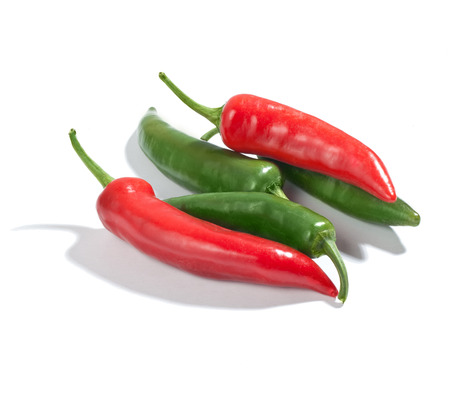 Fresh green and red chilli peppers isolated on white background photo