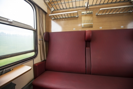 compartment: train compartment with red seats and a view out the window