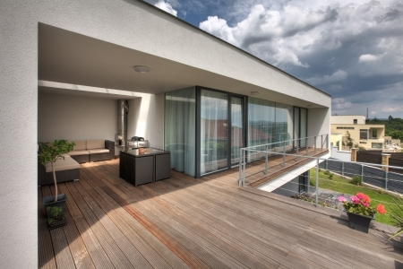 dow: timber pool deck on modern home terrace