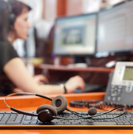 call center with young woman background headpones detail low dept of filed photo
