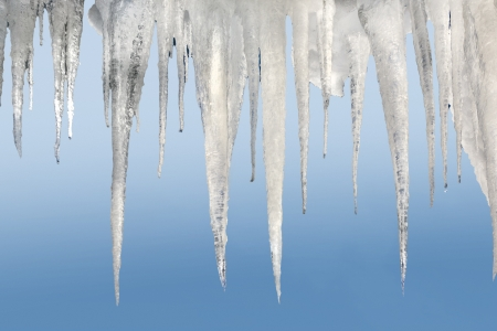 whitw: number of natural icicles on a pale blue background