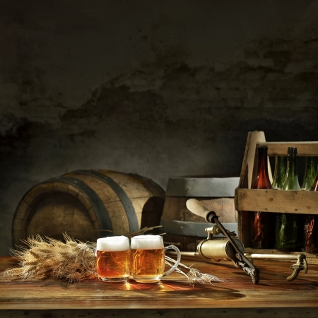 beer still life on the table with old  beer kegs tap photo