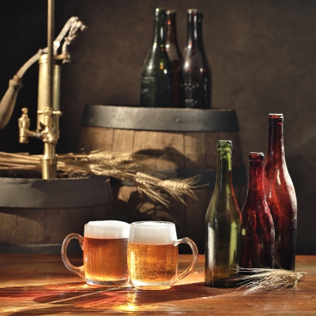 beer tap: beer still life on the table with old  beer kegs tap