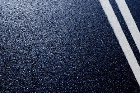 asphalt detail with white double line