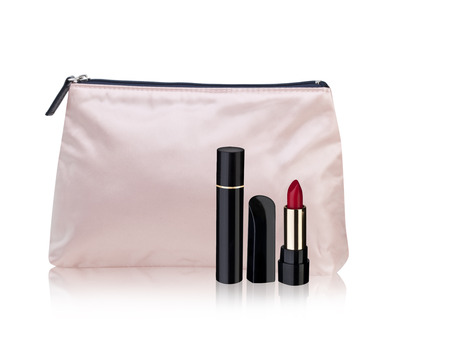vanity bag: light pink cosmetic bag isolated on a white background and red lipstick, red mascara Stock Photo