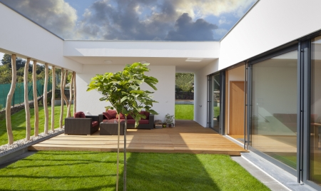 chair garden: Beautiful new peaceful, modern home with privat garden and terrace Stock Photo