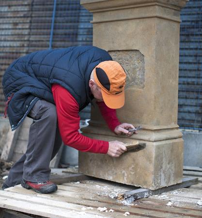man reconstruct old memorial photo