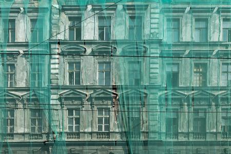 restoration of the facade under green net photo