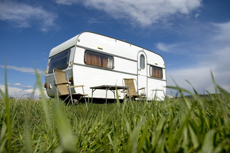 caravan camping with table and two chars