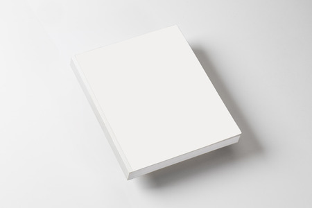 brochure cover: whitte book on a white table with natural shadow