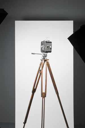 tripod: a movie camera on a tripod isolated on white Stock Photo