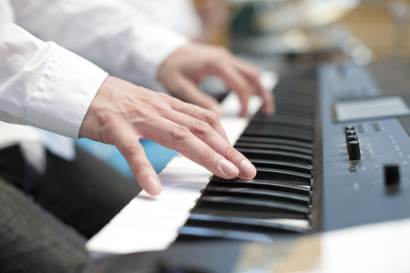 pianist: player pianist fingers on keyboard close up