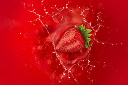 strawberry splash: strawberry splash into juice liquid red Stock Photo