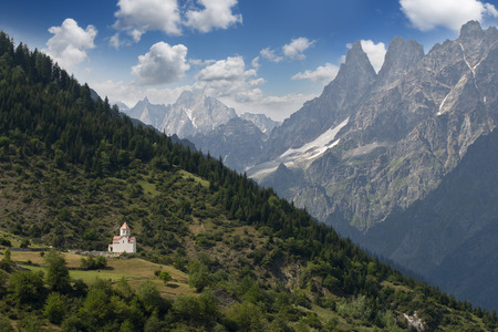 Caucasus mountines with wiew to small church near Mestia direct to Chalati galcier