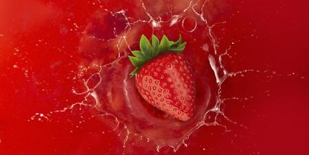 strawberry splash: strawberry splash into red juice liquid