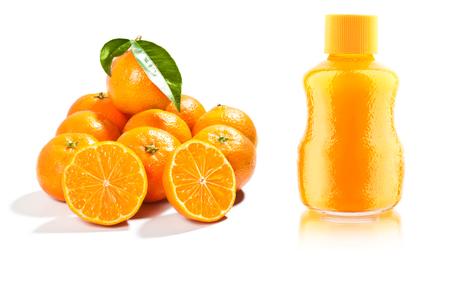 halved  half: fresh mandarins with leaf isolated on white background and juice Stock Photo