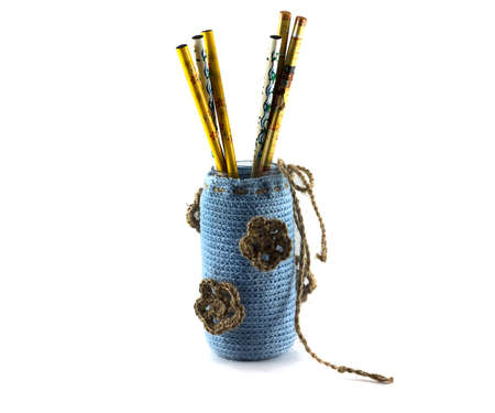 made by hand: Hand made sticks in a vase made of wool Stock Photo