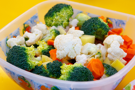 Fresh vegetables are basis of Healthy food. Bright carrots, broccoli, cauliflower, cabbage are ingredients for cooking vegetables and a vegetarian diet. Soft focus.