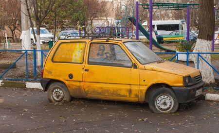 old yellow flat tire car. Russia, Krasnodar.