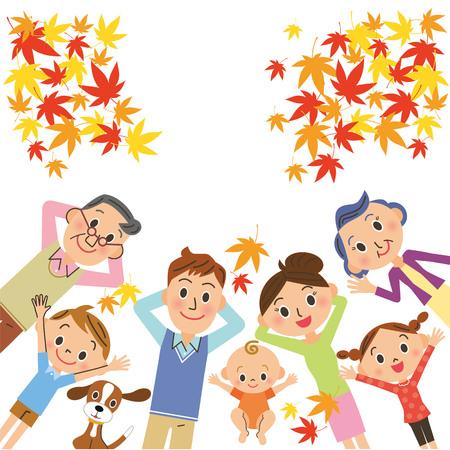 Famiglia di tre generazioni che dorme guardando le foglie d'autunno